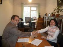 IMPACT President Donald Bowser and Ti Kyrgyzstan Executive Director  Aigul Akmatjanova sign the MoU in Bishkek in December 2011